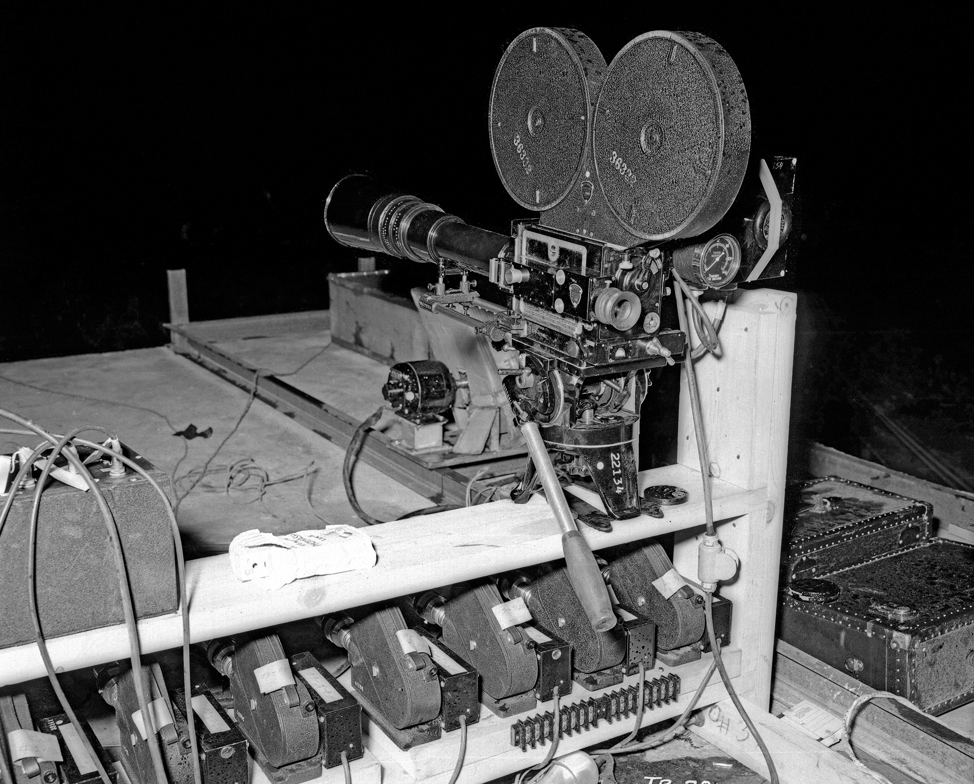 10,000 N shows camera installation on roof of shelter, Cine E cameras under shelf, 24 Mitchell on shelf, B & L Spectrograph in background