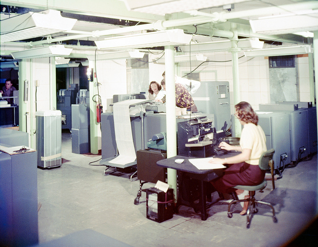 Women working on IBMs and Marchant Machines