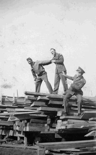 John Crimmons, William McGraw, and Richard Gaul in a Lumber Yard at Los Alamos , 1946