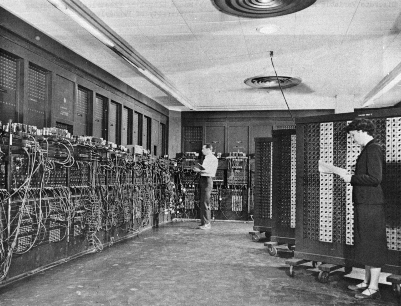 Glen Beck (background) and Betty Snyder (foreground) program ENIAC in BRL building 328. Photo courtesy of the U.S. Army.
