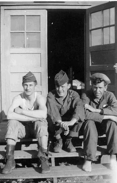 Karl Karpinski, William McGraw, and Sgt Cleo Hamman on the Front Steps of North Wing of the PED Area at Los Alamos, 1946