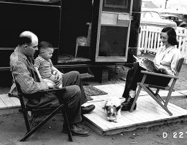 A family living in a trailer at Camp Hanford