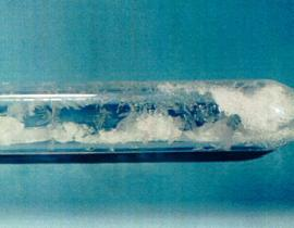 Uranium hexafluoride crystals sealed in an ampoule