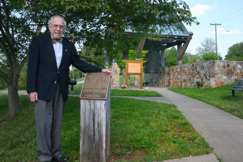 The late Bill Wilcox by the Friendship Bell. Courtesy of the Friends of the International Friendship Bell.