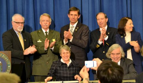 The signing ceremony of park. In the photo are David Klaus, Deputy Under Secretary at DOE; Jonathan Jarvis, Director of the National Park Service, Senators Martin Heinrich, Tom Udall, & Maria Cantwell; Secretaries Sally Jewell & Ernie Moniz