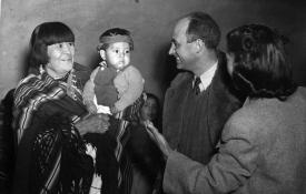 Maria Montoya Martinez and her grandchild with Enrico Fermi. Photo courtesy of the Robert JS Brown Collection.