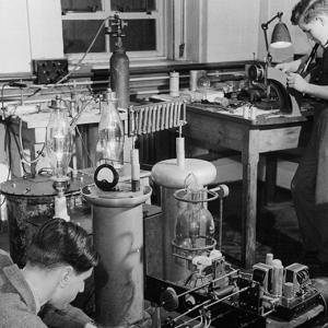 Physicist conduct an experiment at Cavendish