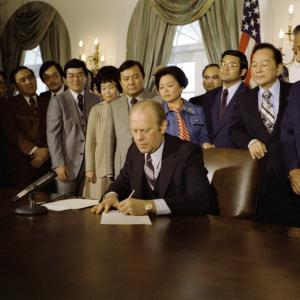 President Gerald R. Ford Signing a Proclamation Confirming the Termination of Executive Order 9066 in the Cabinet Room