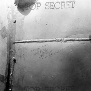 """A Second Kiss for Hirohito!"" Signed by Rear Admiral W.R. Purnell, USN, on the side of Fat Man"