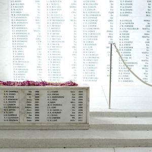 The men aboard the USS Arizona who died in the attack on Pearl Harbor. The plaque in front lists servicemembers who survived the attack and have chosen to be be interred at sea, to be at rest with those who perished in the attack