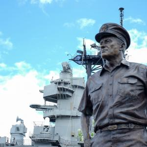 A statue of Admiral Chester Nimitz by the USS Missouri. Admiral Nimitz commanded the Pacific Fleet and served as the Commander in Chief of Pacific Ocean Areas during World War II