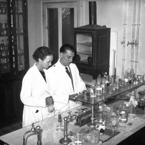 Irène and Frédéric Joliot-Curie in their laboratory in 1935. Picture courtesy of the Bibliothèque Nationale de France.