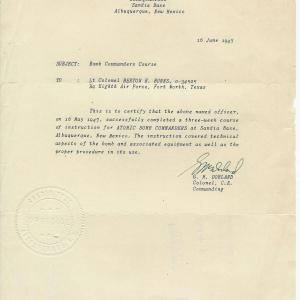 Letter certifying completion of the Atomic Bombs Commander course at Sandia