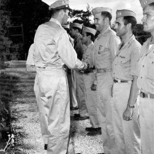 Major Charles Sweeney receiving a decoration after the mission