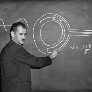 Edwin McMillan explains the science behind the 184 inch cyclotron. Photo courtesy of LBNL.