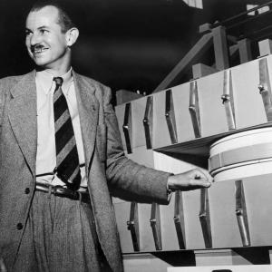 Edwin McMillan with a wooden model of a synchrotron, 1946. Photo courtesy of LBNL.