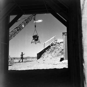 Raising machine gun turret to top of camera shelter, 10,000 yds. N of Ground Zero at Trinity