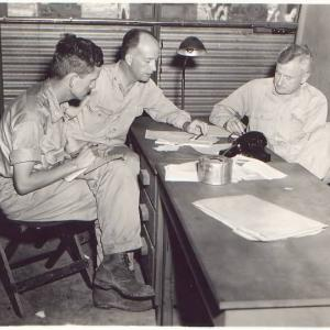 Norman Ramsey, Deak Parsons, and Thomas Farrell meeting on Tinian
