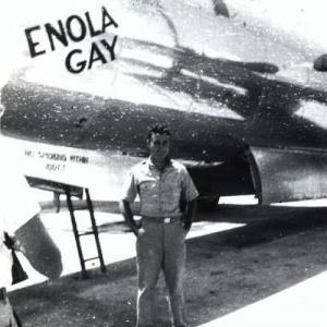 Col. Paul Tibbets stands in front of the Enola Gay