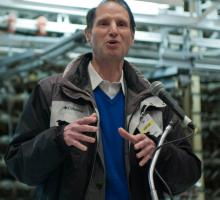 Senator Wyden in front of the face of the B Reactor. Photo courtesy of the U.S. Department of Energy at Hanford.