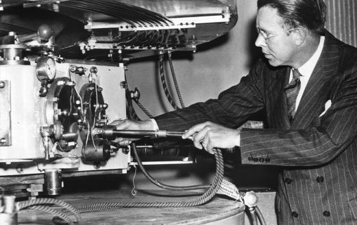 Ernest Lawrence tinkering with his cyclotron