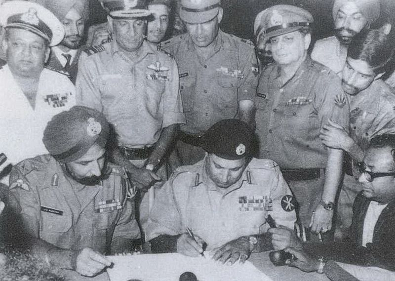 Lieutenant general A. A. K. Niazi signs the Pakistani Instrument of Surrender, December 16, 1971