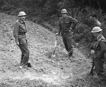 Michael Perrin, John Lansdale, Jr., Samuel Goudsmit, and Eric Welsh search for uranium in a field at Haigerloch, Germany