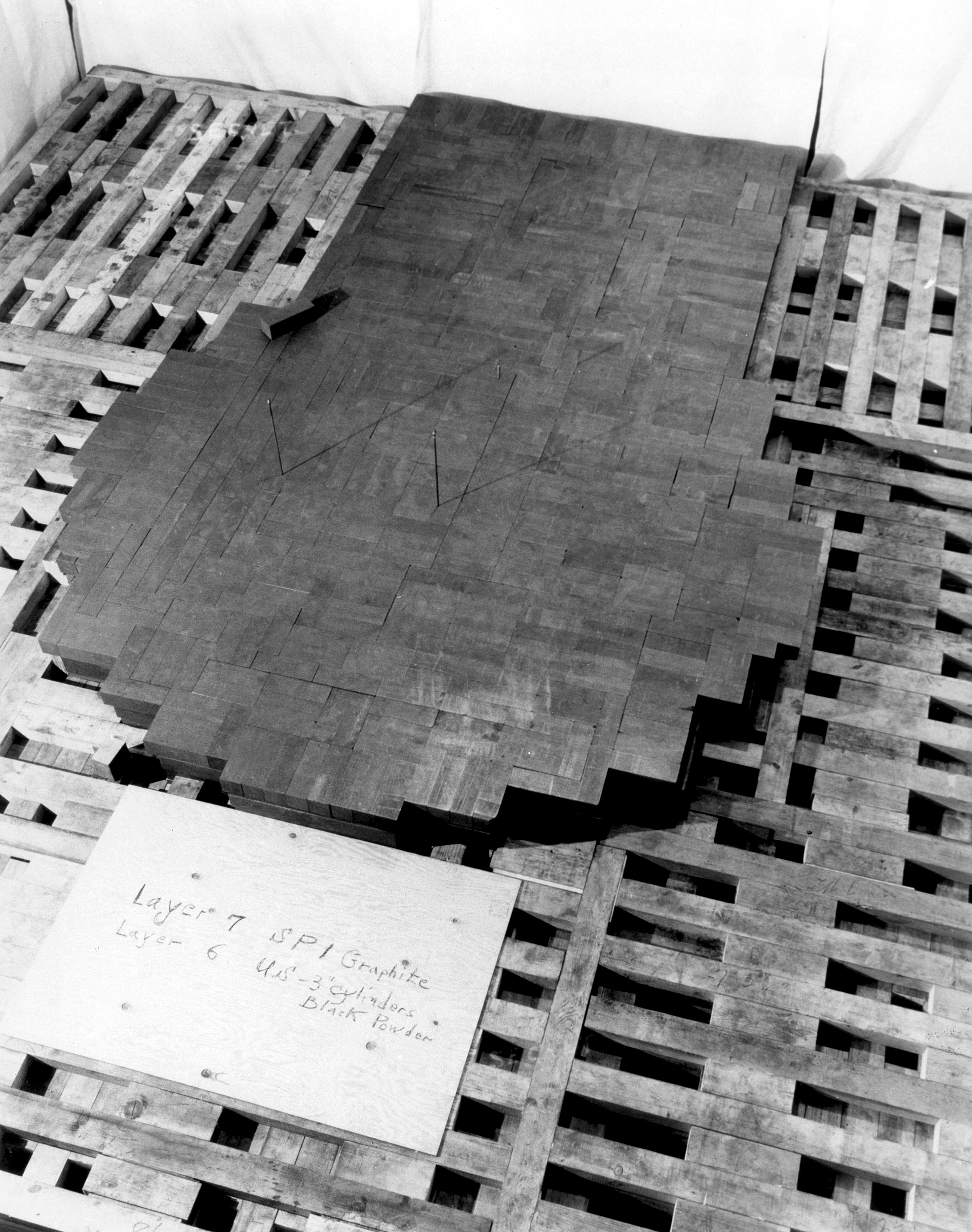 CP-1 during assembly, 1942. Photograph shows the 7th layer of graphite blocks and edges of the 6th layer.