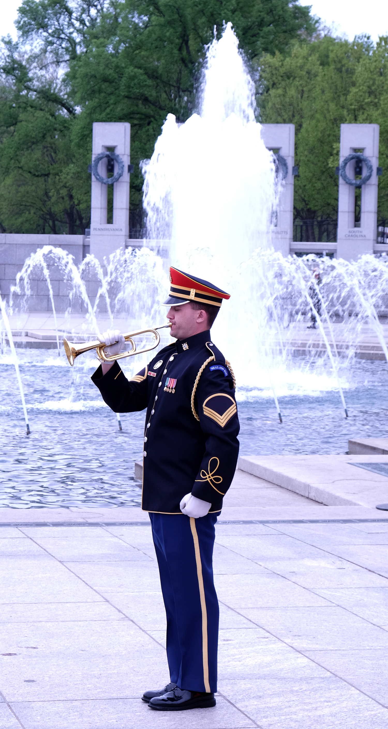Bugle player playing Taps at the Honor Flight ceremony