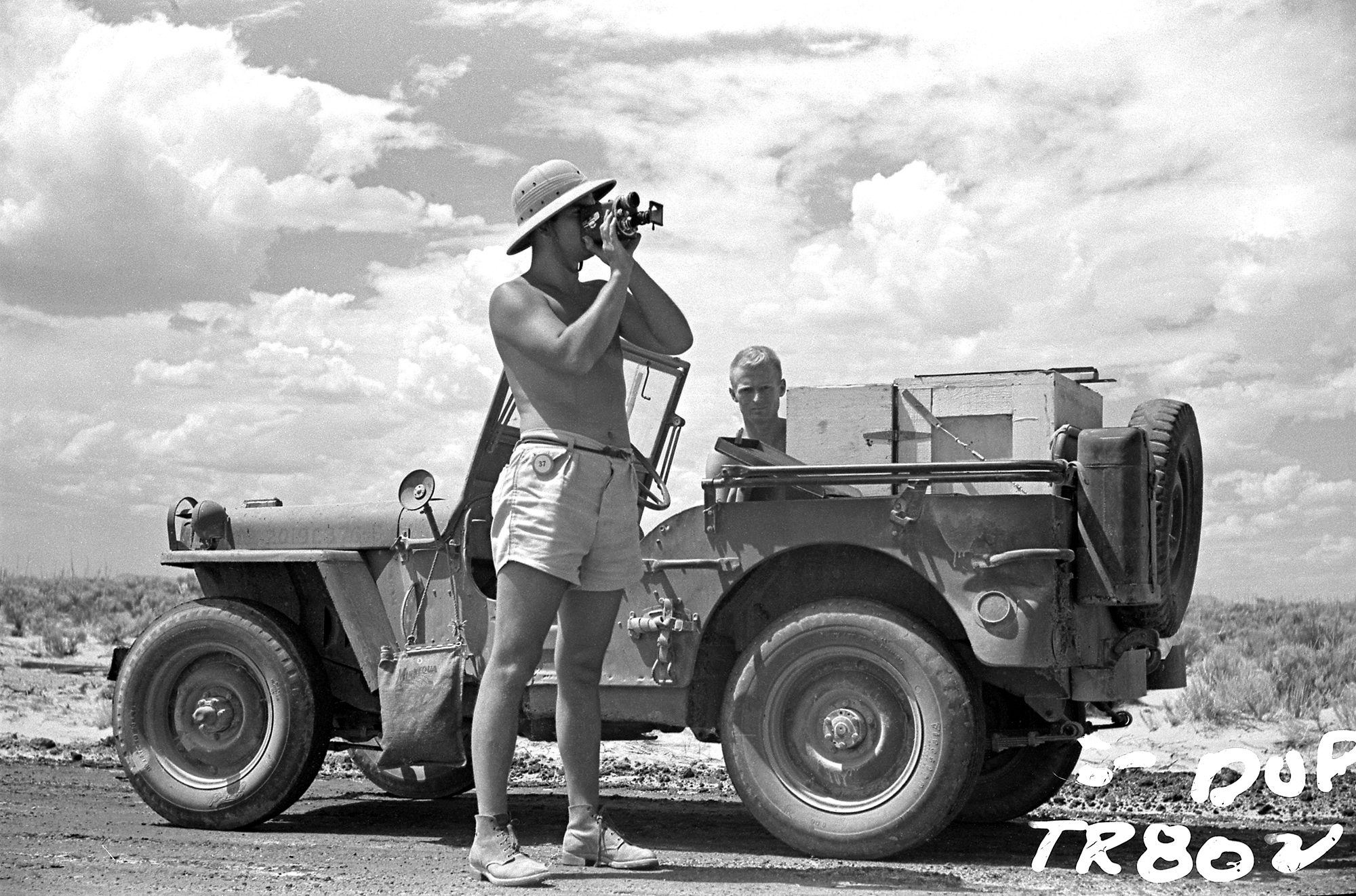 Ernest Wallis, taking pictures with contax camera equipped with telephoto lens