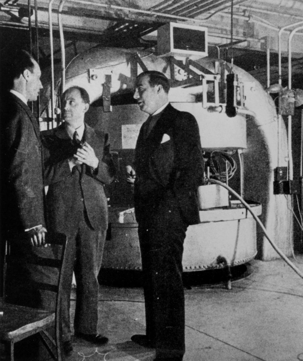 Dana P. Mitchell, Enrico Fermi, and John Dunning with the Columbia cyclotron