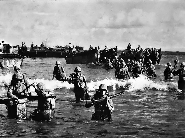 Marines wading ashore on Tinian
