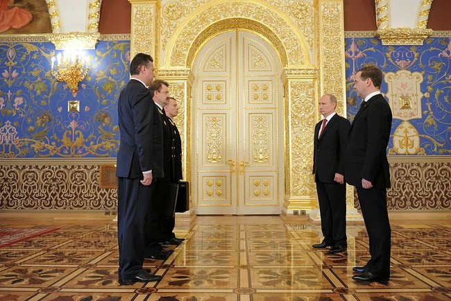Putin takes the cheget back from Dmitry Medvedev at the start of his third presidential term, May 7, 2012