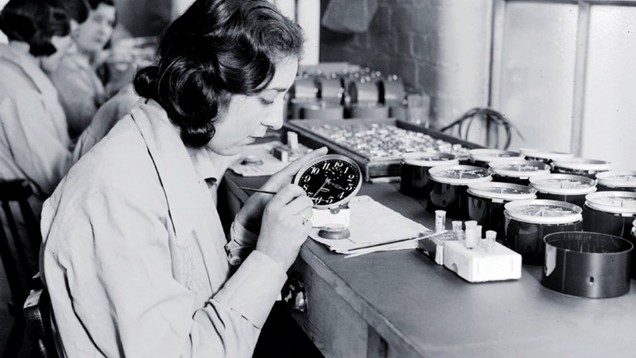 One of the radium girls painting a watch face