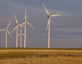 Wind turbines in Caen, France. Photo courtesy of Olivier Tétard, Wikimedia Commons.
