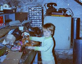 Adam Rondinone in the basement of his parent's house engaged in his favorite hobby, which is taking things apart, at 6 years old. Photo courtesy of Adam Rondinone.