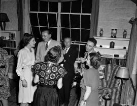 J. Robert Oppenheimer with Eric Jette and others at a party in the Oppenheimer House in 1946