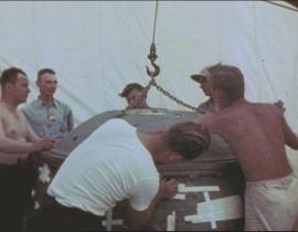 J. Robert Oppenheimer and other Manhattan Project scientists preparing the Gadget before the Trinity Test.