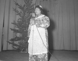 An African-American woman performing during Christmas concert at Hanford during the Manhattan Project