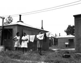 African-American women workers by their hutments in Oak Ridge in 1945 during the Manhattan Project. Photo courtesy of DOE-Oak Ridge
