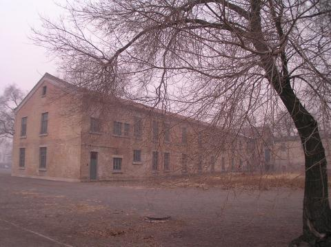 Building on the site of Unit 731. Image courtesy of Wikimedia Commons.
