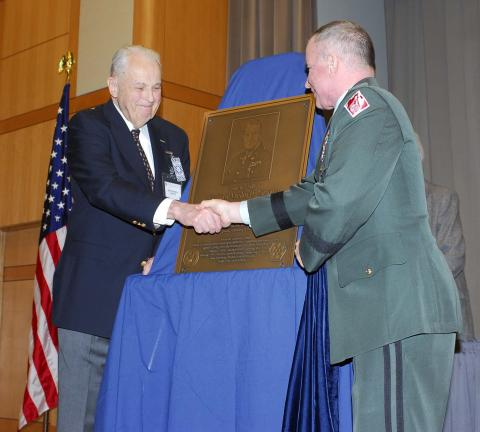 General Richard H. Groves receiving a plaque honoring his father from Major General Merdith W. B. Temple of the Army Corps of Engineers
