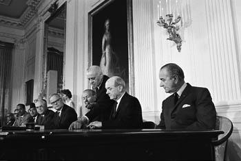 President Lyndon Johnson looking on as Secretary of State Dean Rusk prepares to sign the NPT, 1 July 1968. Photo Courtesy of the Lyndon B. Johnson Presidential Library.