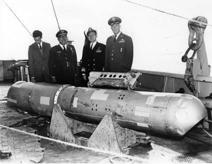 U.S. and Spanish officials with the recovered fourth bomb after the Palomares incident.
