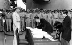 Foreign Minister Shigemitsu signs the Instrument of Surrender