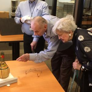 Ted Petry viewing his signature on the Chianti bottle from the 1942 celebration with the other Chicago Pile 1 scientists for successfully creating the first self-sustaining chain reaction. Courtesy of Joseph Dowling