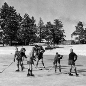 Los Alamos Ranch School boys playing hockey on Ashley Pond, 1924.