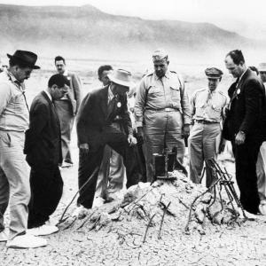 General Groves, Oppenheimer and other scientists inspecting Ground Zero