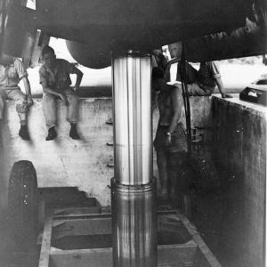 A view from underneath the hydraulic lift, in the bomb bay