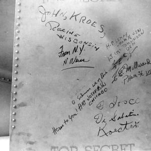 "Signatures on Fat Man's tail assembly. You can see the small signature of ""W. S. Parsons, USN"" or Enola Gay weaponeer Deak Parsons, to the far left"